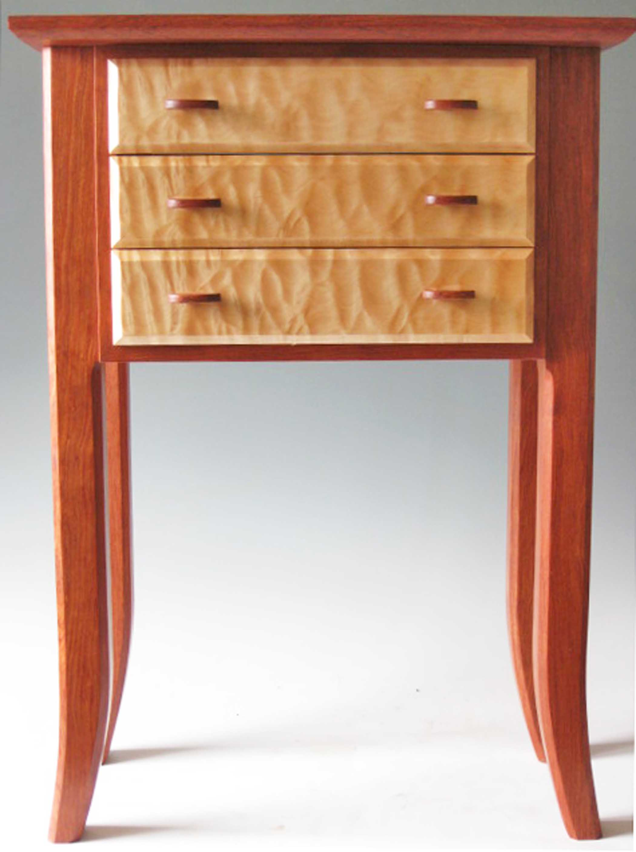 Handmade wooden base table that holds large jewelry armoire box