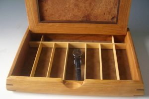 Man jewelry watch box handmade of beautiful woods; photo shows box open with long compartments to hold watches