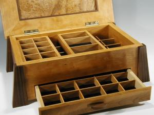 Handmade wooden jewelry box made of cherry and burl; this photo displays the inside of box with drawer open and dividers for jewelry