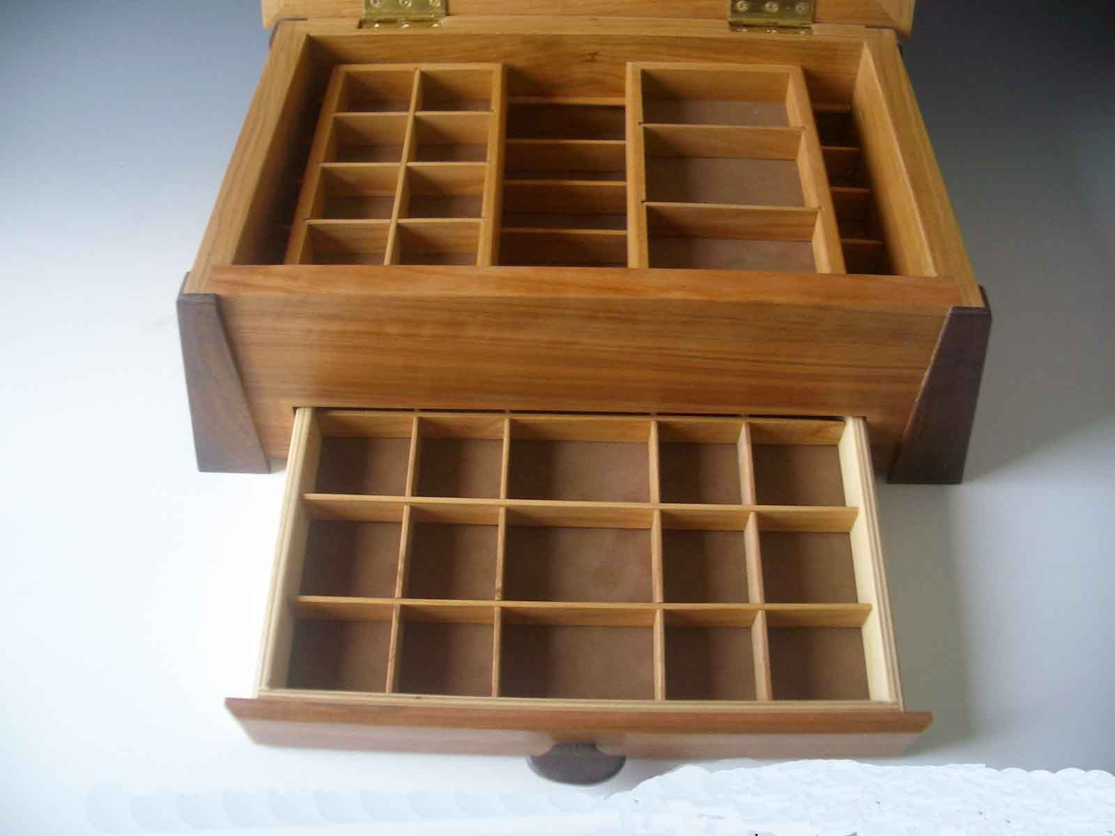 Handmade solid wood jewelry boxes made of various exotic woods; this example shows inside of box with drawer open and dividers for jewelry