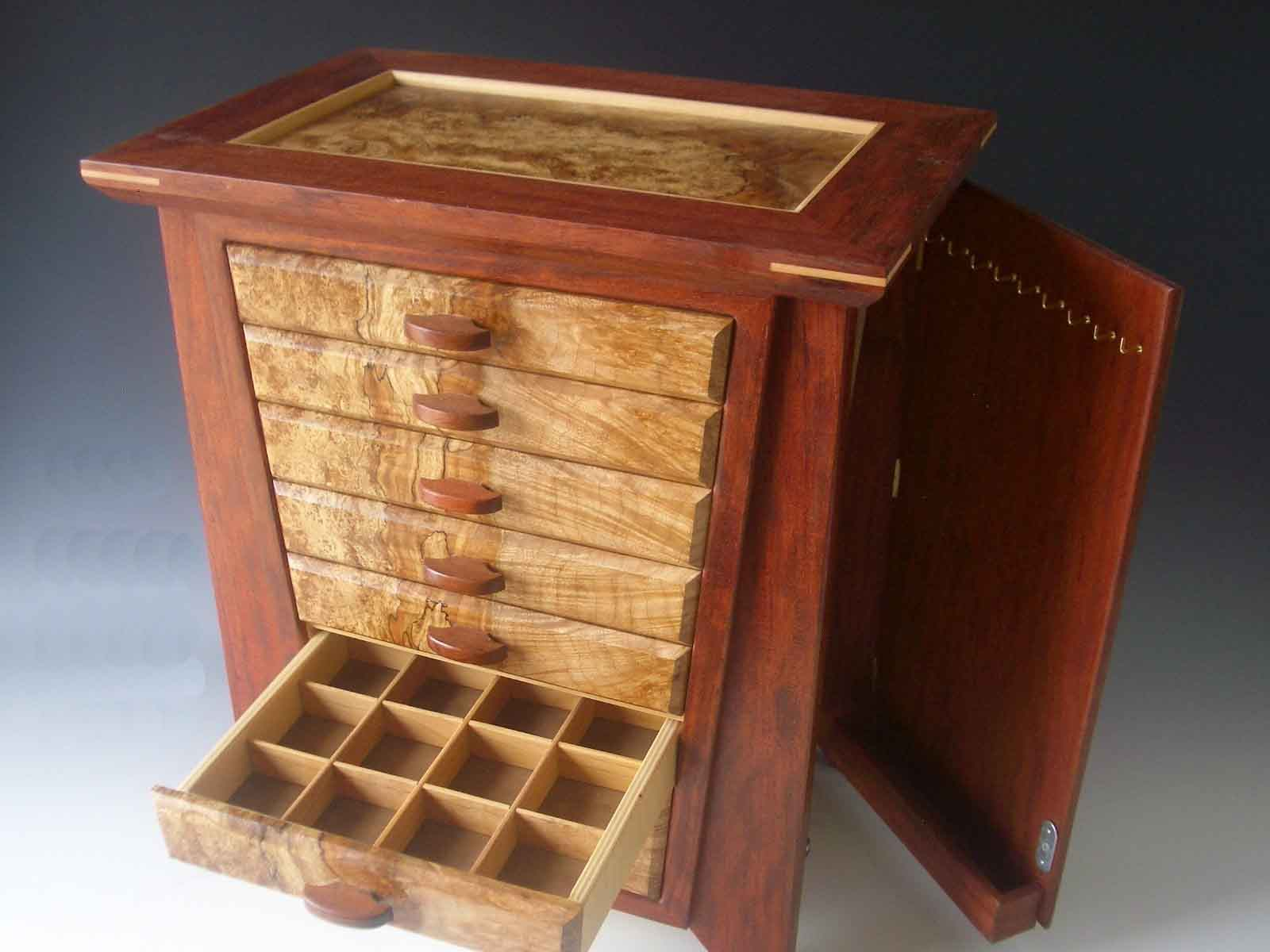 Handmade exotic wood jewelry box made of bubinga wood and burl; with seven drawers and a door that has nine hooks for necklaces