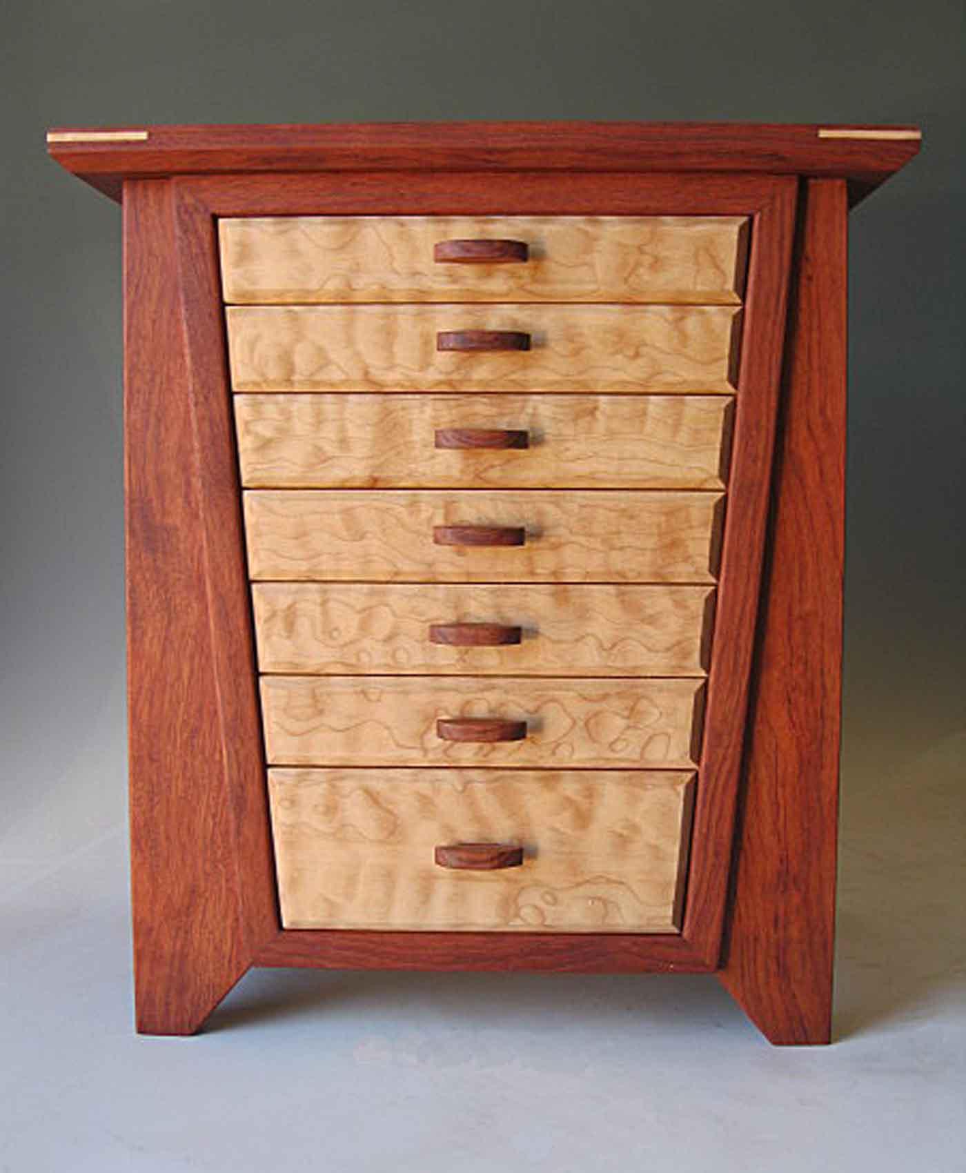 Handmade quality jewelry box made of bubinga wood and burl; with seven drawers