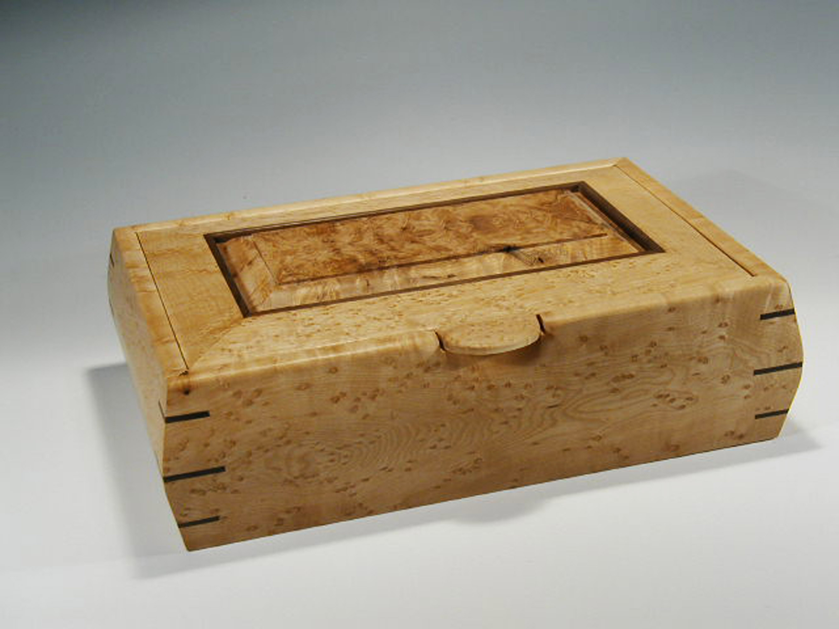 Handmade wooden jewelry box that has a lid that lifts open; this box is made of birdseye maple