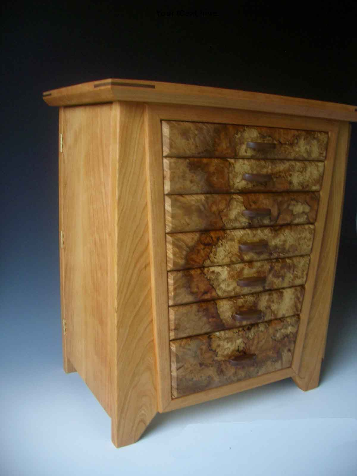 Handcrafted large jewelry box made of cherry wood with seven drawers for jewelry