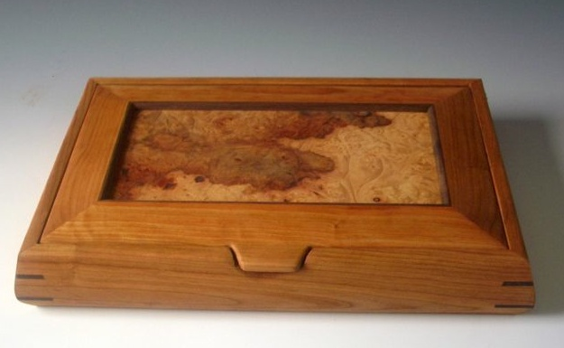 Decorative wooden box made of cherry wood with a beautiful patterned maple burl piece for the lid