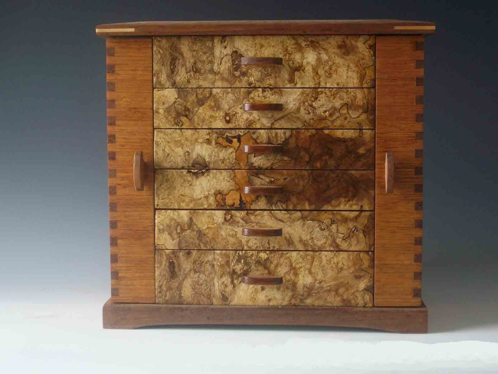 Handmade standing jewelry box made of cherry wood and burl; with two side doors and six drawers