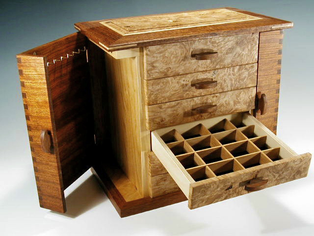 One of my most popular handcrafted jewelry boxes, the Swingdoor, shown with one drawer and door open.