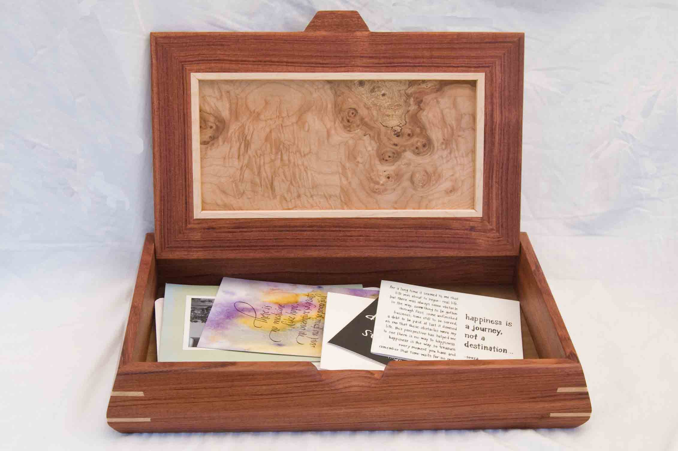 One of my handcrafted wooden boxes made of beautiful woods shown with its lid open and holding birthday cards