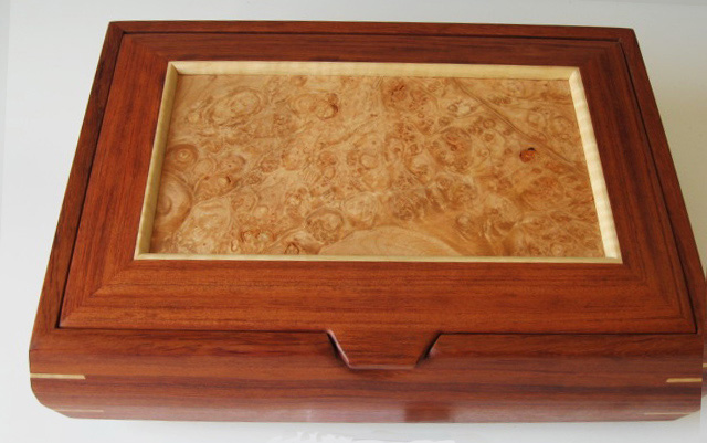 A handmade decorative box made of bubinga wood from Africa and a maple burl lid