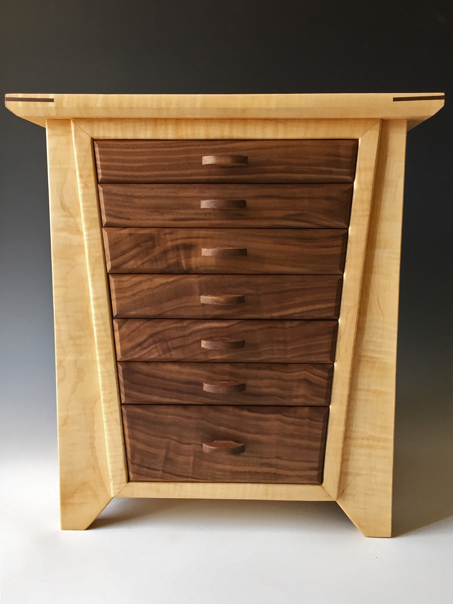 Photo of my large jewelry box, the Angle, made of curly maple with black walnut drawers.