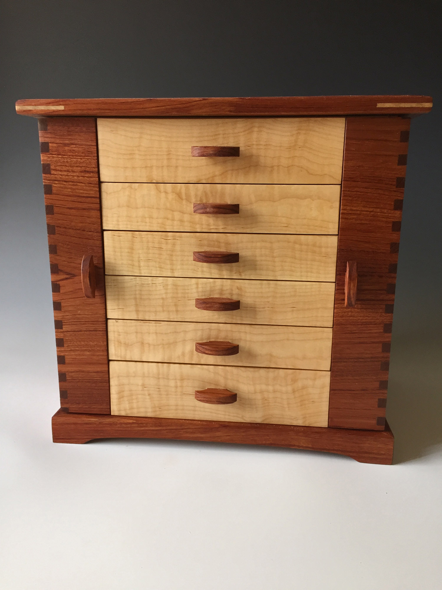 Photo of my standing jewelry box which I call the Swingdoor; made of bubinga and curly maple woods.