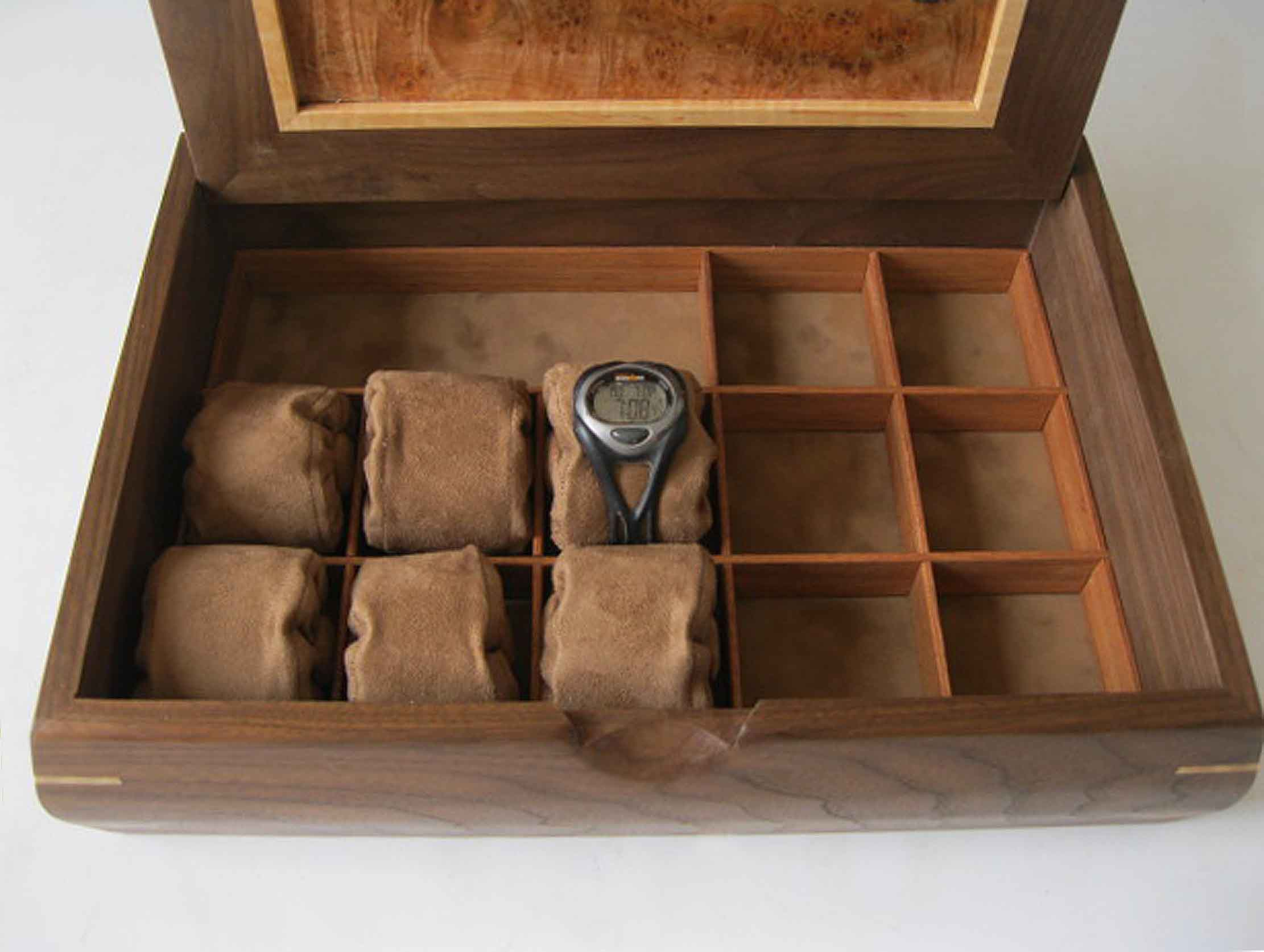 This watch jewelry box is handmade of black walnut; the optional watch rolls are perfect for storing watches