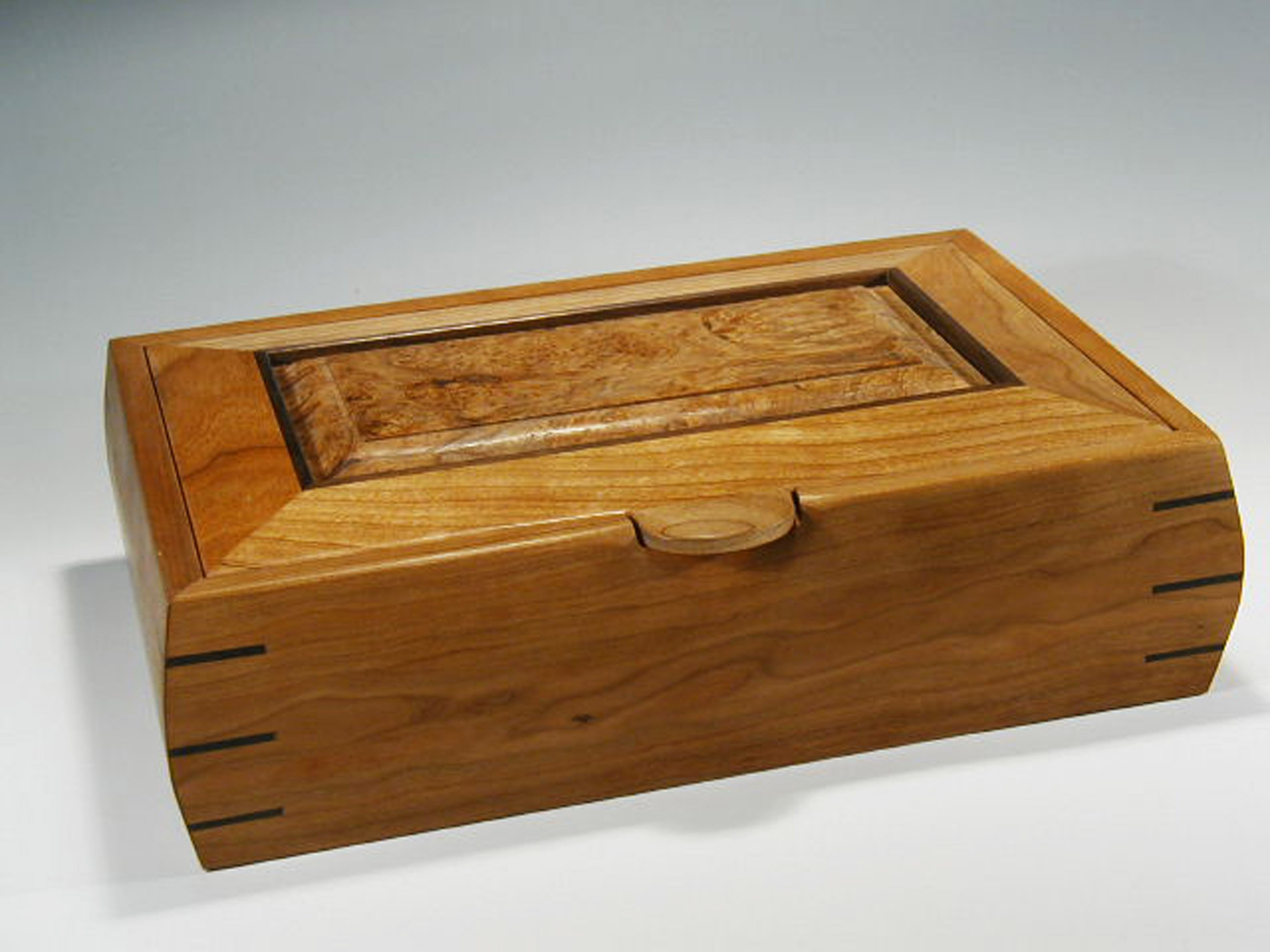 This is one of my handmade wooden boxes that can be used as a watch jewelry box; it is made of cherry wood.