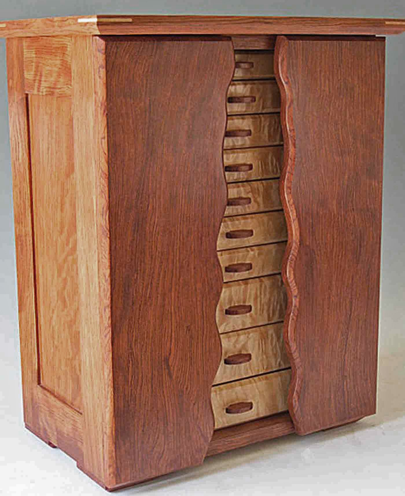 My armoire jewelry box, a tall box with ten drawers and sliders to hold necklaces.