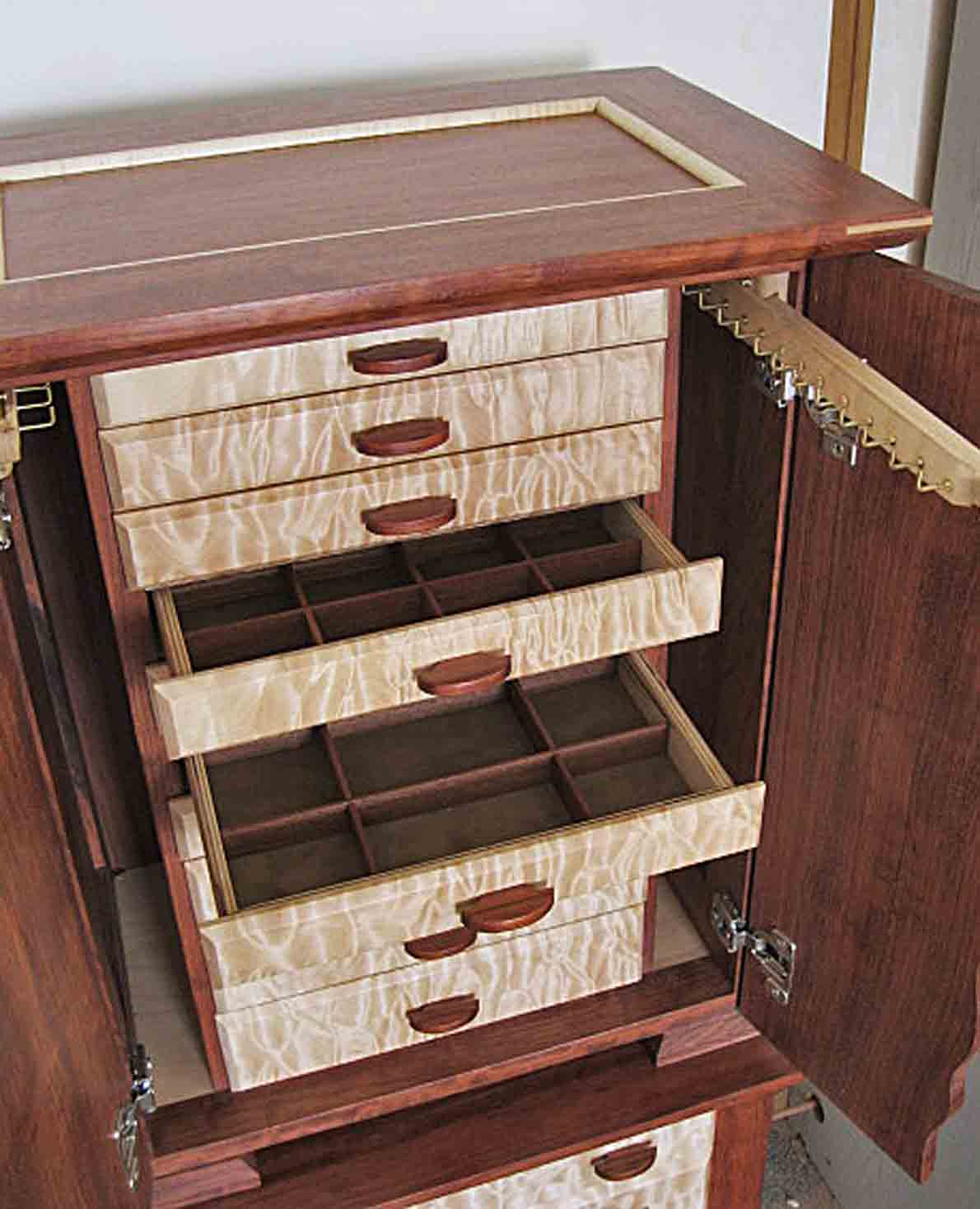Handmade wooden large jewelry box shown with jewelry storage drawers open